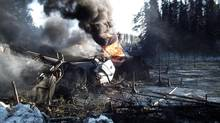 This photo provided by the Transportation Safety Board of Canada shows a ruptured tank car on fire after a crude oil train derailment south of south of Timmins, Ont. (The Canadian Press)