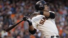This July 14, 2012 file photo shows San Francisco Giants' Melky Cabrera swinging for an RBI single off Houston Astros' Lucas Harrell in the fifth inning of a baseball game in San Francisco. (Associated Press)