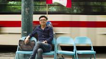 Tinghui Ye, who goes by Alex, 42, wrote his Canadian citizenship exam only hours before this portrait on Spadina Rd. in Toronto on June 27, 2012. The four-year resident of Canada, originally from China, is hoping that he passed the exam and will become a Canadian citizen. (Peter Power/The Globe and Mail)