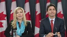 Former Conservative MP Eve Adams (left) is joined by Liberal Leader Justin Trudeau as she announces in Ottawa on Monday, Feb. 9, 2015 that she is leaving the Conservative Party to join the Liberal Party of Canada. (Justin Tang/THE CANADIAN PRESS)