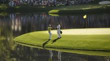 Rory McIlroy and his caddy, girlfriend Caroline Wozniacki, on the eighth green Wednesday. McIlroy knows how to cope with and use Augusta National's undulations. 'It's obviously a very strategic golf course,' he says. (MARK BLINCH/REUTERS)