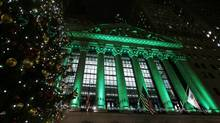 A festively lit NYSE building, Dec. 11, 2012. It's time to get back into the stock market, either in one fell swoop or by investing periodically throughout the year. (CARLO ALLEGRI/REUTERS)