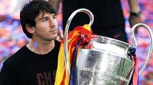 Lionel Messi of FC Barcelona holds the UEFA Champions League Trophy during the celebrations after winning the UEFA Champions League Final against Manchester United, at Camp Nou Stadium on May 29, 2011 in Barcelona, Spain. (Photo by David Ramos/Getty Images) (David Ramos/Getty Images)