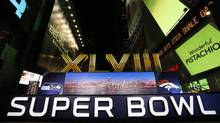 In this Jan. 29, 2014 file photo, the Super Bowl XLVIII Roman Numerals are unveiled in New York. (Doug Benc/AP)