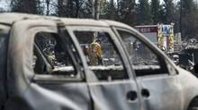 Crews are working in Slave Lake, Alberta, shutting of gas and water in burned out neighbourhoods on Wednesday May 18, 2011. A wildfire swept through the town of 7,000 destroying upwards of 40% of the buildings. (Ian Jackson/Ian Jackson/The Canadian Press)
