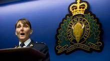 RCMP Insp. Paulette Freill reads a statement during a news conference in regards to charges against a Dutch man in relation to the death of Amanda Todd, in Surrey, B.C., on Thursday April 17, 2014. A 35-year-old man alleged to be involved with the online extortion of her 15-year-old daughter, who committed suicide in 2012, was arrested in the Netherlands. (Darryl Dyck/The Canadian Press)