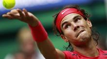 Rafael Nadal of Spain serves a ball to Lukas Lacko of Slovakia at the Halle Open ATP tennis tournament in Halle June 14, 2012. REUTERS/Ina Fassbender (INA FASSBENDER/REUTERS)