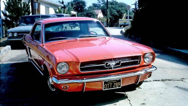The Poppy Red Mustang Laki Malamatenios got in 1964. In 1969 he passed up the chance to trade it in and says he knew then that he'd keep it forever. (COURTESY OF LAKI MALAMETENIOS/NYT)
