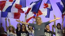 In this Sept. 18, 2016, file photo, France's far-right National Front president Marine Le Pen waves to supporters during a summer meeting in Frejus, southern France. (Claude Paris/AP)