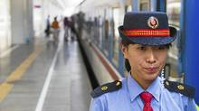 An attendant waits for the Shenzhen to Shanghai train to depart. (Mitch Moxley for The Globe and Mail/Mitch Moxley for The Globe and Mail)