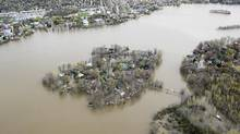Ile Mercier covered in floodwater is seen on the Riviere des Prairies on the north part of Montreal on Monday. The bridge leading to the island is closed with its residents evacuated. (Paul Chiasson/THE CANADIAN PRESS)