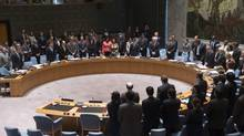 Members of the UN Security Council stand in a moment of silence on Thursday for the lives lost on Malaysia Airlines Flight MH17. (John Minchillo/AP)