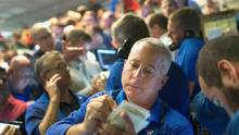 Traders fill orders at the Chicago Board Options Exchange (CBOE) on August 24, 2015 in Chicago, Illinois. (Scott Olson/Getty Images)