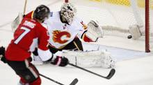 Ottawa Senators Kyle Turris scores on Calgary Flames goalie Karri Ramo during second period NHL action Sunday March 30, 2014 in Ottawa. (Adrian Wyld/THE CANADIAN PRESS)