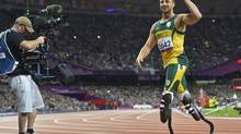 Oscar Pistorius of South Africa leaves the track after winning his men's 200m T44 classification heat in a new world record time at the Olympic Stadium during the London 2012 Paralympic Games September 1, 2012. (TOBY MELVILLE/REUTERS)