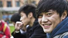 Asian students (Huchen Lu/Getty Images/iStockphoto)