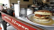 Pulled Pork Pancakes with Jack Daniels maple syrup are served at the Red Wagon Cafe, 2296 East Hastings Street in Vancouver, BC. (Laura Leyshon for the Globe and Mail)