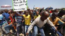 Striking platinum miners march near the Anglo-American Platinum mine near Rustenburg, South Africa in this Oct. 5, 2012 file photo. (MIKE HUTCHINGS/REUTERS)