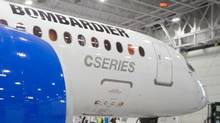 Bombardier's CS300 Aircraft sits in the hangar prior to its test flight in Mirabel on February 27, 2015. (© Christinne Muschi / Reuters)