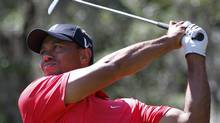 Tiger Woods watches his tee shot on the fifth hole during final round play in the Arnold Palmer Invitational PGA golf tournament in Orlando, Florida, March 25, 2012. REUTERS/Joe Skipper (JOE SKIPPER)