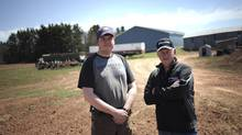 Potato farmer Richard Gorrill (right) and his son Shane (left) at Richard's farm outside O'Leary, P.E.I., Tuesday, May 7, 2013. (Nathan Rochford)