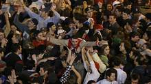 Boston Red Sox fans celebrate after Boston defeated St. Louis Cardinals in Game 6 (Associated Press)