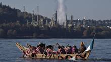 Members of the first nations sleil-Waututh, Squamish and Musqueam bands paddle in a traditional canoe during a Thanksgiving protest in North Vancouver, British Columbia October 14, 2013. The group are protesting the Trans Mountain Pipeline Expansion by energy company Kinder-Morgan and the increase of tanker traffic in the Burrard Inlet. (Andy Clark/Reuters)
