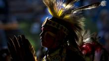 A native dancer performs in the Indian Village during the 101st Calgary Stampede in Calgary, Alberta Saturday, July 13, 2013. (Kevin Van Paassen/The Globe and Mail)