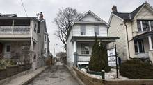 Toronto's housing market contrasts with Vancouver's slowdown. After implementing a tax on foreign buyers, Vancouver has seen a 56-per-cent decline in sales valued at over $1-million so far this year. (Fred Lum/The Globe and Mail)