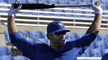Toronto Blue Jays batter Jose Bautista stretches during batting practice at their MLB American League spring training facility in Dunedin, Florida February 20, 2012. (MIKE CASSESE/Reuters)