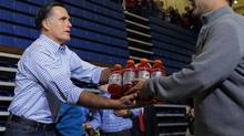 U.S. Republican presidential nominee Mitt Romney accepts relief supplies for people affected by Hurricane Sandy at a storm relief campaign event in Kettering, Ohio October 30, 2012. (BRIAN SNYDER/REUTERS)