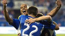Montreal Impact's Blake Smith, right, celebrates with teammates Davy Arnaud (22) and Matteo Ferrari after scoring against Sporting Kansas City during second half MLS soccer action in Montreal, Saturday, July 27, 2013. (Graham Hughes/THE CANADIAN PRESS)