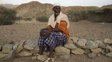Abdu Ibrahim Mohammed, a retired salt merchant, poses for a photograph close to his home in the town of Berahile in Afar, northern Ethiopia April 20, 2013. (STRINGER/REUTERS)