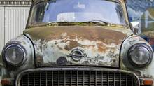 The logo of the carmaker Opel is seen on the rusty bonnet of a vintage Opel Caravan estate vehicle in Berlin, August 23, 2012. (THOMAS PETER/REUTERS)