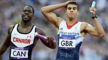 Britain's Adam Gemili (R) and Canada's Justyn Warner react after their men's 4x100m relay round 1 heat at the London 2012 Olympic Games at the Olympic Stadium August 10, 2012. (Dylan Martinez/REUTERS)