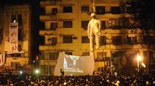 Protesters react in Tahrir Square to Egyptian President Hosni Mubarak's televised speech in Cairo February 1, 2011. Mubarak, responding to huge popular protests demanding the end of his 30-year rule, said on Tuesday he would not seek re-election in a ballot scheduled for September but would stay in office until then to respond to demands for reform. An effigy of Mubarak is hung up at the centre of the square. (Dylan Martinez/Reuters/Dylan Martinez/Reuters)