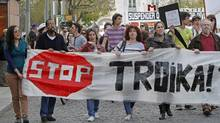 Protesters carry a banner during the Portuguese general strike in Lisbon March 22, 2012. (HUGO CORREIA/HUGO CORREIA/REUTERS)
