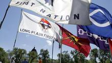 Various First Nations flags fly on the grounds of a protest camp in Memorial Park near the Legislature in Winnipeg Sept. 3, 2014. (Lyle Stafford For The Globe and Mail)