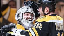 Tim Thomas #30 and Nathan Horton #18 of the Boston Bruins celebrate the win in Game Five of the Eastern Conference Quarterfinals during the 2011 NHL Stanley Cup Playoffs at TD Garden on April 23, 2011 in Boston, Massachusetts. The Boston Bruins defeated the Montreal Canadiens 2-1 in double overtime. (Photo by Elsa/Getty Images) (Elsa/2011 Getty Images)
