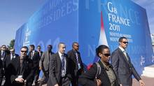 French police officers walk in front of the Deauville Congress Center, in Deauville, western France on Monday, May 23, 2011 where world leaders of the G8 will meet for a summit May 26 and May 27. (Markus Schreiber/AP/Markus Schreiber/AP)