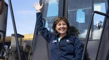 BC Liberal Leader Christy Clark waves to supporters from a front-end loader during a campaign stop at Kentron Construction, in Kitimat, B.C. on April 13, 2017. (Robin Rowland/THE CANADIAN PRESS)