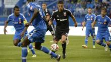 D.C. United midfielder Luis Silva (11) dribbles the ball around Montreal Impact defense during the first half at Stade Saputo on June 11, 2014. (Eric Bolte/USA Today Sports)