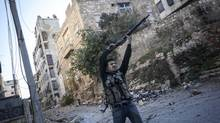 A Syrian rebel fighter aims at government forces during skirmishes in Aleppo. The Assad government continues to regain territory, making it less likely to agree to a deal at the Geneva conference. (Narciso Contreras/ASSOCIATED PRESS)