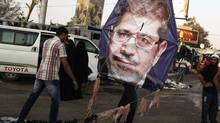 Supporters of deposed Egyptian President Mohamed Morsi in the sit-in area of Rab'a al-Adawiya Square, where they are camping, in Cairo on Aug. 12, 2013. (ASMAA WAGUIH/REUTERS)