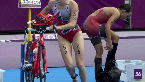 Canadians Paula Findlay, left, and Kathy Tremblay of Canada make the first transition in triathlon competition at the 2012 Olympic Games in London on August 4, 2012. (Frank Gunn/THE CANADIAN PRESS)