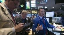 Traders work on the floor of the New York Stock Exchange Jan. 27, 2014. (BRENDAN MCDERMID/REUTERS)