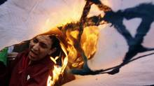 Egyptians protesters burn an Israeli flag during an anti-Israel demonstration in front of the Press Syndicate in Cairo March 27, 2010 . (Amr Abdallah Dalsh/Reuters)