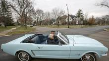 Tom and Gail Wise cruise the streets of Park Ridge, Ill., in her 1964 Ford Mustang convertible, the first Mustang ever purchased in the United States. (JOHN GRESS/REUTERS)