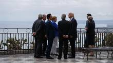 G7 leaders speak during a walking tour on May 26, 2017, in Taormina, Italy. U.S. President Donald Trump has shown no interest in the migrants file during the summit. (Evan Vucci/AP)