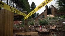 Police tape and an empty fire extinguisher are seen outside a $16-million vacant home that was damaged by fire in the Point Grey neighbourhood of Vancouver, B.C., on Thursday November 10, 2016. (DARRYL DYCK/THE GLOBE AND MAIL)